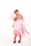 Big hug. The little girl is giving a big hug to her friends royalty free stock photo