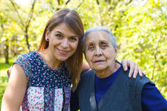 Big hug for Grandma. Picture of a beautiful young women with her grandmother Royalty Free Stock Photo