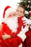 Big Hug for Santa. Cute little boy giving Santa Claus a big hug on Christmas morning Stock Photography