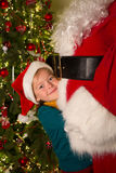 Big hug for santa claus. Happy little girl giving santa claus a big hug Stock Photography