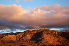 Big huge sunset clouds over the red mountains in Tucson Arizona Stock Image