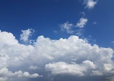 Big huge white clouds forming over blue sky Stock Photography