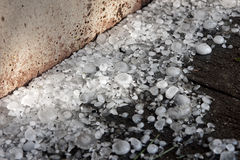 Big ice balls hail on the wooden floor Royalty Free Stock Photos