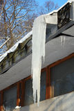Big icicle on a building roof Stock Image