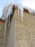 Big icicles on the roof Stock Image