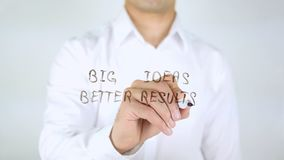Big Ideas Better Results, Man Writing on Glass, Handwritten Royalty Free Stock Images