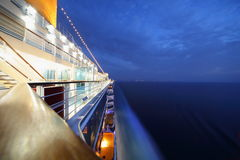 Big illuminated cruise ship riding in evening. Royalty Free Stock Image