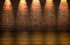 Big illuminated room. With brickwall and wooden floor royalty free stock photography
