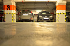 Two cars in underground parking Stock Photos