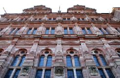 Big, important and historic building with glass windows and coats of arms in Heidelberg in Germany Stock Images