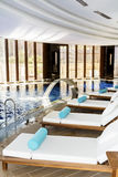 Big indoor  luxury pool with spa sunbeds Royalty Free Stock Photo