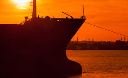 Big industrial cargo ship bow silhouette Stock Images