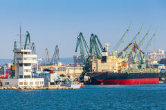 Big industrial cargo ship is loading in port Stock Photo