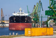 Big industrial cargo ship and yellow container Royalty Free Stock Photo