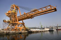 Big industrial crane at a harbor. Orange, industrial Stock Photography