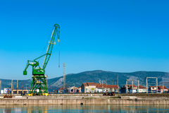 Big industrial crane in river harbor Royalty Free Stock Image
