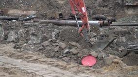 Big industrial excavator digging up ground, urban development. Bulldozer scoop working in construction site.  stock video footage