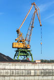 Big industrial harbor crane stands on the coast in port Royalty Free Stock Image