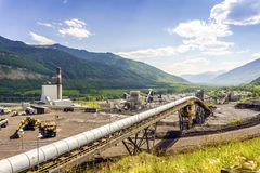 Big industrial infrastructure among mountains in Canada. Big industrial infrastructure among Rocky Mountains in Alberta, Canada Royalty Free Stock Images
