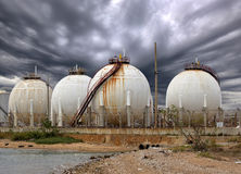 Big Industrial oil tanks in a refinery and Drainage system with Royalty Free Stock Images