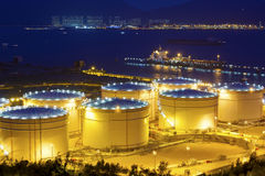 Big Industrial oil tanks in a refinery at night Stock Image