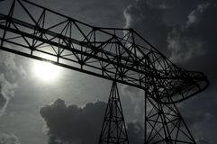 A big industrial structure under the Sun. An old industrial structure, the Sun and the clouds. This structure is along the Tevere river in Rome Stock Photos