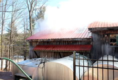 Maple sugar shack and vats. Big industrial vats used to help process sap from maple trees into sweet grades of maple sugar Stock Photos