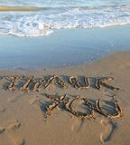 big inscription Thank you on the sea beach and the wave that is