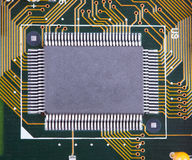 Big integrated microcircuit. The big integrated microcircuit on a circuit board surface Stock Photos