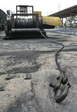 Big iron industry with rope. From transport machine on cement floor Stock Photos