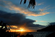 Big Island Sunset in Blue and Gold Royalty Free Stock Image