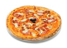 Big italian pizza with ham and mushrooms Royalty Free Stock Images