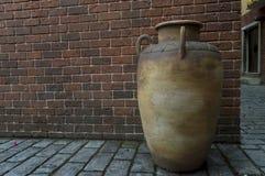 Big Jar. A clay big jar with wall bricks behind Royalty Free Stock Photography