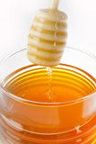 Big jar of honey Stock Photos