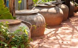 Old jar keep rainwater. Big jar rainwater storage for household Royalty Free Stock Photography