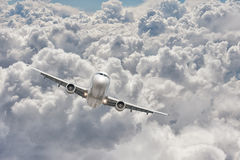 Big jet plane flying through the clouds stock photos