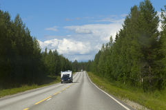 Big journey. Caravan on the road. In Finland Royalty Free Stock Photo