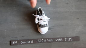 Big journeys begin with small steps, vintage style stock footage