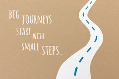 Big journeys start with small steps. Handmade paper collage quote Royalty Free Stock Image