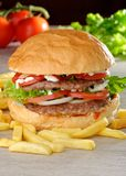 Big juicy double burger with french fries Royalty Free Stock Image