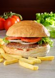 Big juicy gourmet burger Royalty Free Stock Photo