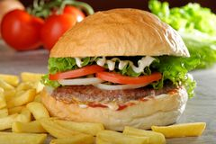 Big juicy gourmet burger Royalty Free Stock Photography