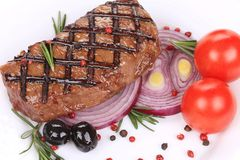 Big juicy grilled steak with greens. Stock Photography