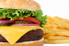 Big juicy hamburger and fries Royalty Free Stock Photography