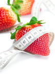 Big juicy red ripe strawberries and measure tape Royalty Free Stock Photos