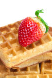 Big juicy ripe strawberries and waffles Royalty Free Stock Photography