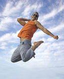 Big jump. Young active man making a big jump Stock Image