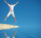Big Jump. A man jumping into the air and spreading his arms and legs Stock Photography