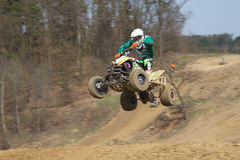 Big jump with quad motorbike. All trademarks are removed. Royalty Free Stock Photos