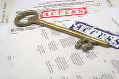 Big key and access. Old key on 100 year old and the word access Stock Images